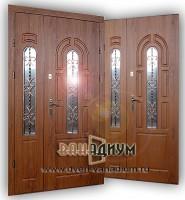 Металлическая дверь со стеклом и ковкой СК21